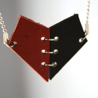 Broken heart necklace in black and red leather two pieces.