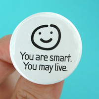 "you are smart, you may live. 1.25"" smiley face button."