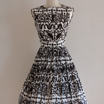 1960s Serbin of Florida black and white brocade print day dress / vintage Rorschach dress