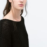Sweater with rounded hem