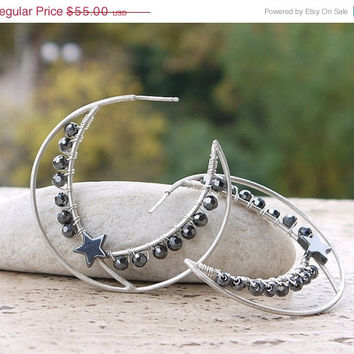 ON SALE Silver hoop earrings with black hematite. Geometric hoop earrings with round hematite stones and a black star