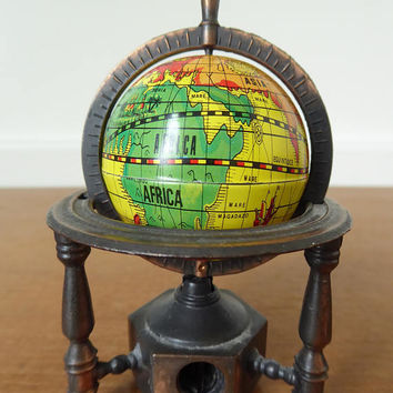 Metal globe pencil sharpener, globe spins