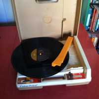 Fisher price portable record player; brown and orange
