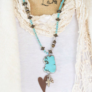 Unique and really HOT! Howlite turquoise necklace with a large howlite turquoise pendant with an antiqued heart and a cross