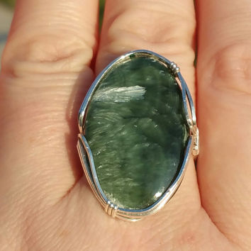 Seraphanite gemstone ring wrapped in .925 sterling Silver   You pick the size you want custom size 4-14 unisex