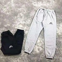 NIKE Autumn And Winter New Fashion Embroidery Letter Hook Keep Warm Women Men Pants Gray