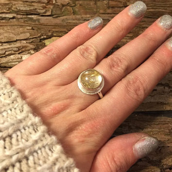 Handmade sterling silver rutilated quartz statement ring.