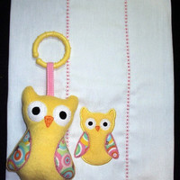 Yellow owl burp cloth with matching owl toy with c clip for girls. Burp cloth can be personalized for an extra charge.