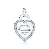 Tiffany & Co. -  Return to Tiffany™ heart tag charm of 18k white gold and diamonds.
