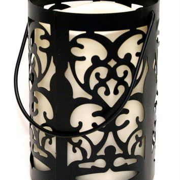 """7"""" Black Metal Flourish Lantern with Bisque LED Lighted Flameless Indoor-Outdoor Pillar Candle"""