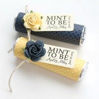 navy and yellow polka dot wedding favors with navy and yellow roses