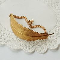 golden feather bracelet by maria allen jewellery | notonthehighstreet.com