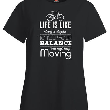 Life Is Like Riding A Bicycle To Keep Your Balance - Ladies T Shirt