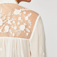 FLOWING SHIRT WITH LACE DETAILS