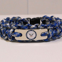 US Navy survival strap bracelet in blue camo parcord and USN engraved emblem on stainless steel charm