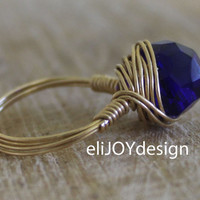 Gold and Saphire solitaire wire wrapped ring. Royal blue wire wrapped ring. Rustic glam peacock blue faceted stone. Deep blue and gold Ring.