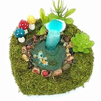 Fairy garden koi fish pond with bright colorful mushrooms and shell waterfall.