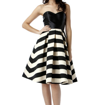 This sleeveless dress features stripe design, form fitting black top, sweetheart neckline with slip resistant gel around bust-neckline, structure box pleated a-line skirt, exposed black back zipper closure. Unlined. Pair with single strap front open toe sa