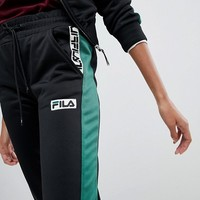 Fila Tracksuit Bottoms With Contrast Side And Logo Taping at asos.com