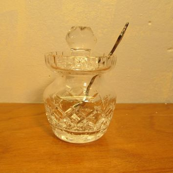 crystal jam or honey pot with lid and spoon