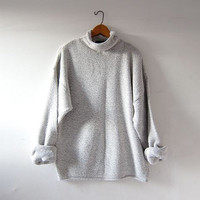 vintage speckled sweater. oversized cotton sweater. light gray blue white colors. minimalist.