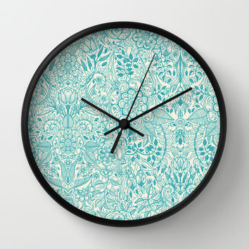 Detailed Floral Pattern in Teal and Cream Wall Clock by Micklyn