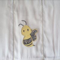 Embroidered burp cloth with an applique bumble bee in bright yellow and black. Can be personalized for an extra charge.