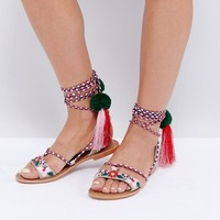 Glamorous Multi Pom and Tassel Tie Up Flat Sandals at asos.com