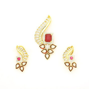 Diamond Pendant and Earring in 18Kt Gold and 3.45 Ct diamonds and 5.54Ct Ruby in center