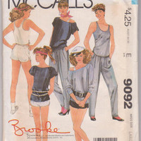 Vintage 1980s Brooke Shields activewear pattern for 3 raglan sleeve tops, short shorts, tapered pants misses size L 18 20 McCalls 9092 UNCUT