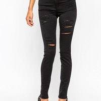ASOS Ridley Skinny Jeans in Washed Black with Extreme Thigh Rips