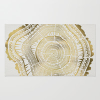 Gold Tree Rings Rug by Cat Coquillette