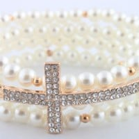 2 Pieces of White Simulated Pearl with Goldtone Iced Out Sideways Cross Style Beaded Stretch Bundle Bracelet