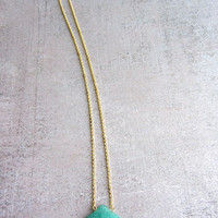 Long gold necklace with a blue turquoise quartz geometric faceted gemstone, triangle pendant.