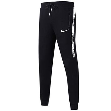 NIKE 2018 autumn and winter new sports fitness men and women models trousers training casual pants Black
