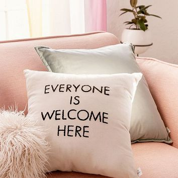 UO Community Cares + Housing Works Everyone Is Welcome Pillow | Urban Outfitters