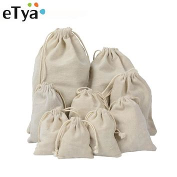 eTya Handmade Cotton Linen Storage Package Bag Drawstring Bag Small Coin Purse Travel Women Small Cloth Bag Christmas Gift pouch