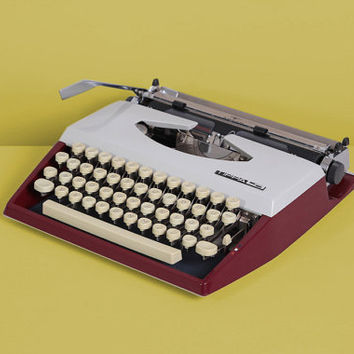 1972 Adler Tippa S Typewriter. Excellent fully working conditon. Burgundy and silver. Slim and portable. With Case.