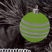 black and white photograph of a christmas bauble, christmas decoration, hand colored photo, green decor