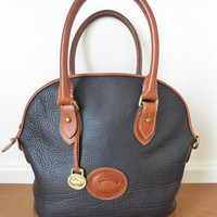 Vintage Dooney and Bourke black leather Norfolk Satchel Shoulder Bag with two interior pockets, all weather bag