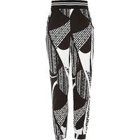 River Island Girls black mixed print joggers