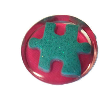 Autism Awareness Aqua Glitter Puzzle Piece Resin Magnet With Pink Background