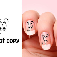 Set of 20 Smiley Face nail art decals.