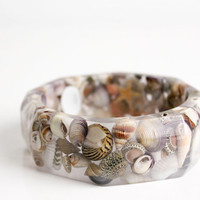 Real shells and starfish suspended in eco resin octagonal bangle