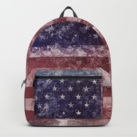 US Flag worn out Backpacks by Claude Gariepy