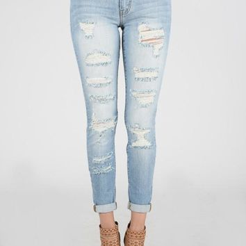High Rise Light Ripped Skinnies