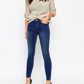 ASOS Skinny High Rise Ankle Grazer Jeans In Sunday Wash at asos.com