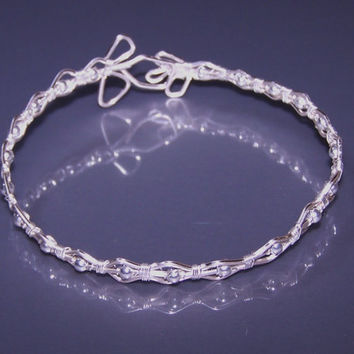 Wire Wrapped Silver Plated Bracelet With Two Stylized Flowers