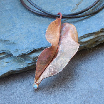 Copper leaf pendant with Labradorite gemstone. Handmade fold formed and hammered.