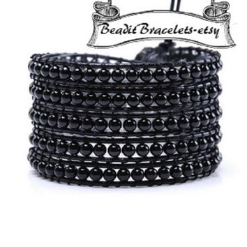 Leather wrap bracelets made with 2 mm black Agate beads on Black leather. 5 x wrap is adjustable